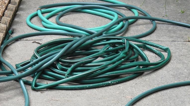 Messy kinked hose pile